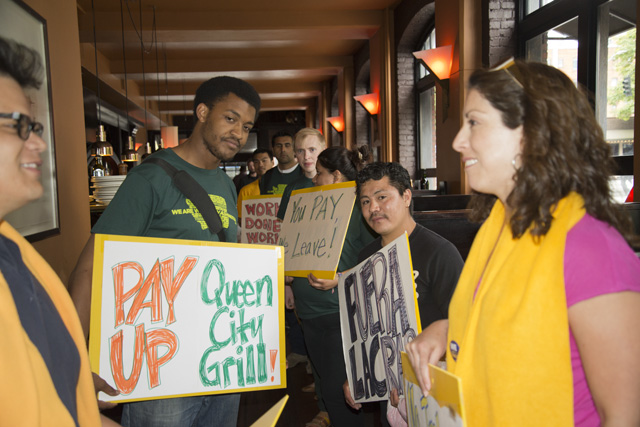 Representatives of Working Washington, UFCW 21 and Casa Latina picket the Queen City Grill in June.  Photo: Allegra Abramo.